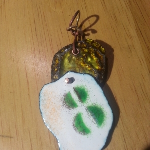 Enamel work and a recycled bottle cap