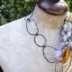 Abstract yarn necklace with steel links and organic embellishments